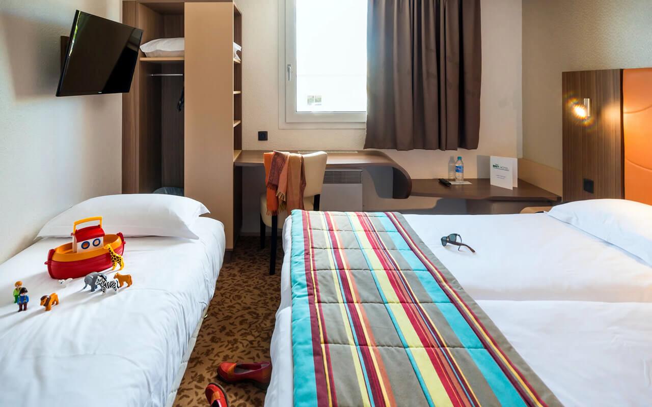BRIT HOTEL NANTES ST HERBLAIN - LE KERANN bedroom in ST HERBLAIN